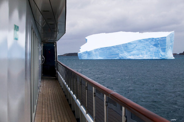 An iceberg visible from the deck of a ship