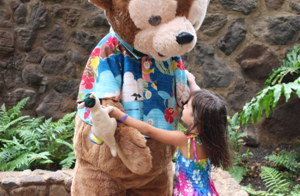 A young girl embraces the character of Duffy the Disney Bear at Aulani