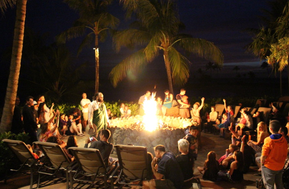 Families gather around the fire pit for story time at Disney Aulani Resort in Hawaii