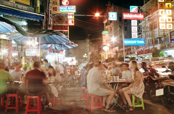 People dining in Bangkok's Chinatown at streetside stalls