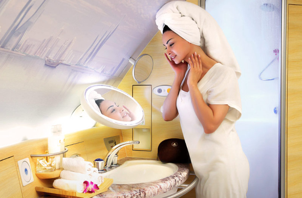 A woman enjoy the Shower Spa in Emirates A380 First Class