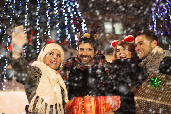 Smiling people celebrate Christmas in Europe.