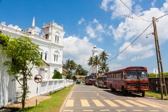 Colonial buildings and buses in Galle Fort