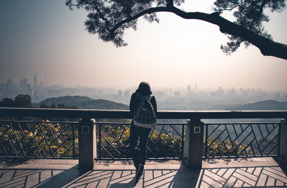 A female tourist admires the cityscape of Guangzhou in China