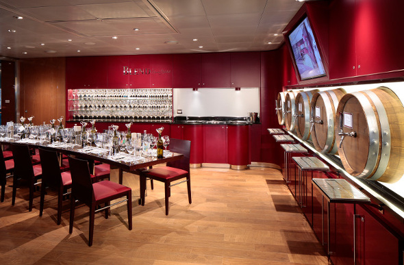 Wine barrels line the walls at BLEND, where you can create your own drop on board Holland America Line's MS Koningsdam.
