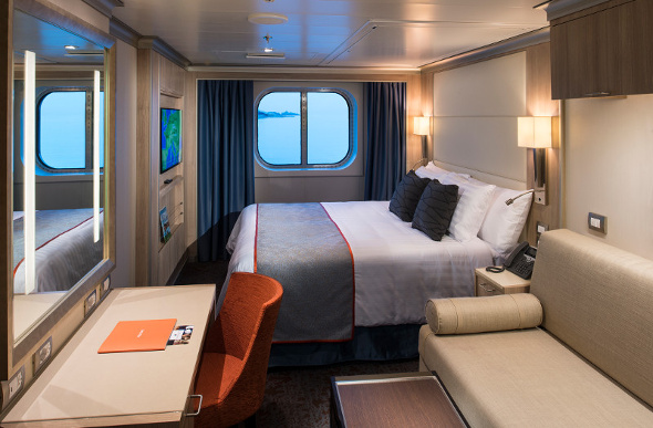 A family room on Holland America Line's MS Koningsdam affords a view of the ocean.