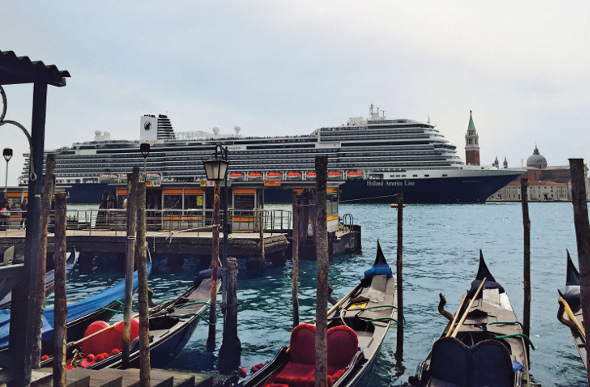 The MS Koningsdam rises above the moored gondolas in Venice.
