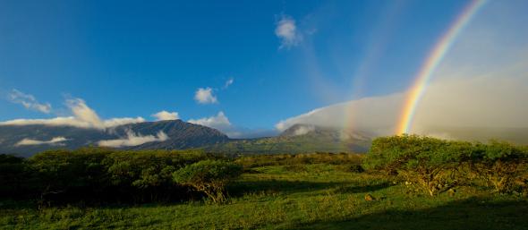 Rainbow over valley Kaupo Gap Hawaii