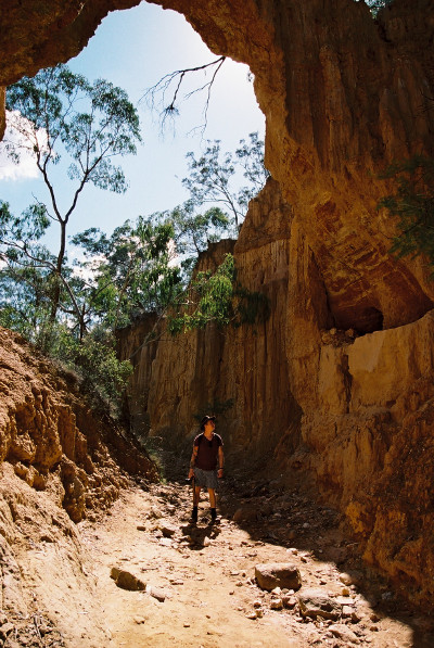 man standing in riverbed at golden gully hill end nsw