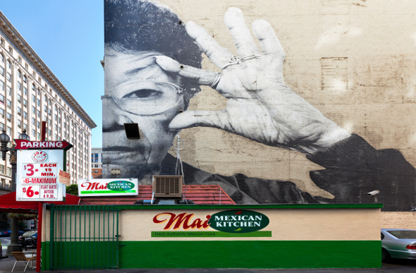A graphic mural takes up an entire wall of a building on Spring Street in Los Angeles