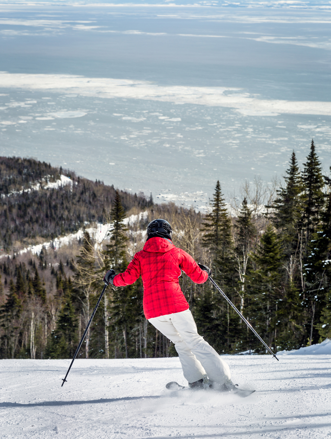 A woman skies down Le Massif in Charlevoix
