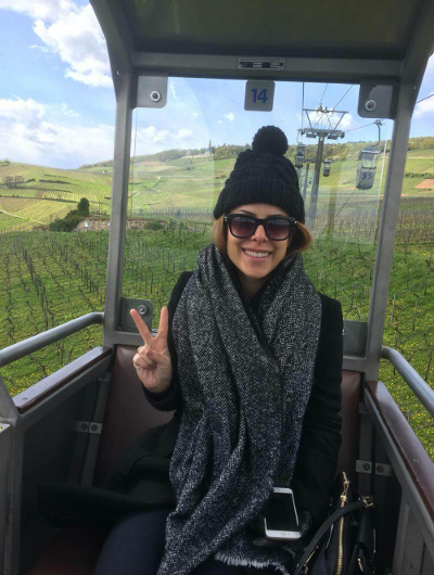 A female takes a selfie in the cable car over the Rhine Valley in Rudesheim