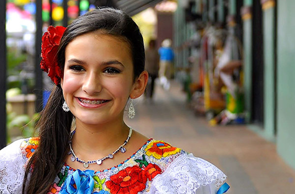 A young female singer in traditional Mexican dress at San Antonio's Market Square