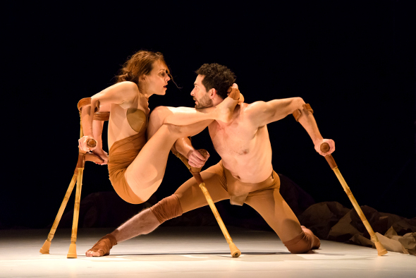 man and woman dancing on stage with crutches