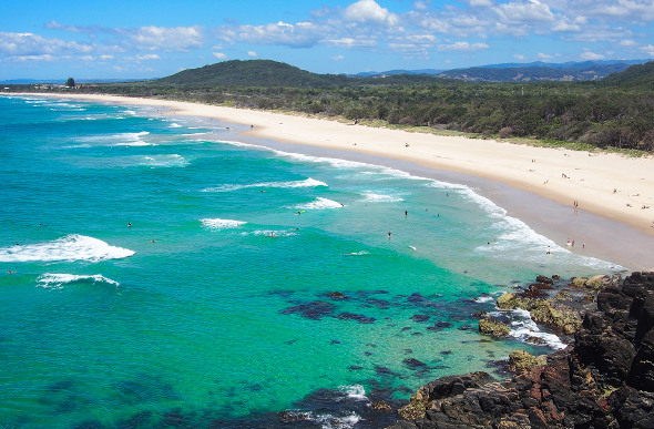 The wide sweep of sand and blue-green water of Cabarita Beach in New South Wales.