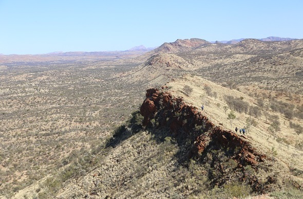 People hiking up Euro Ridge Larapinta Trail NT