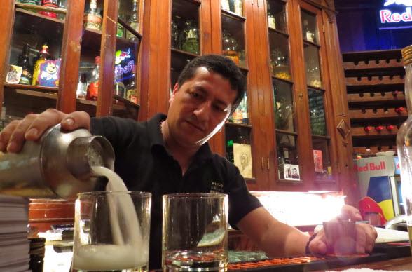 Pouring Peru's famous pisco sour.