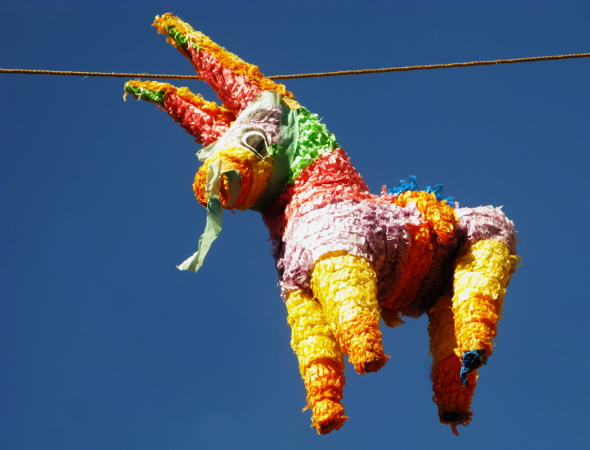 A colourful pinata of a donkey hangs in the sky. This is a popular pastime for Cinco de Mayo celebrations
