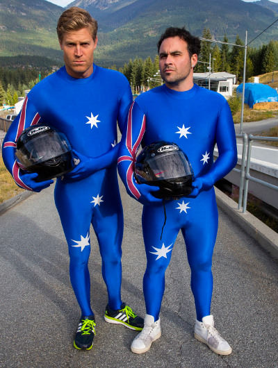 TV hosts Miguel Maestre and Chris Brown wear Lycra suits emblazoned with the Australian flag for bobsledding