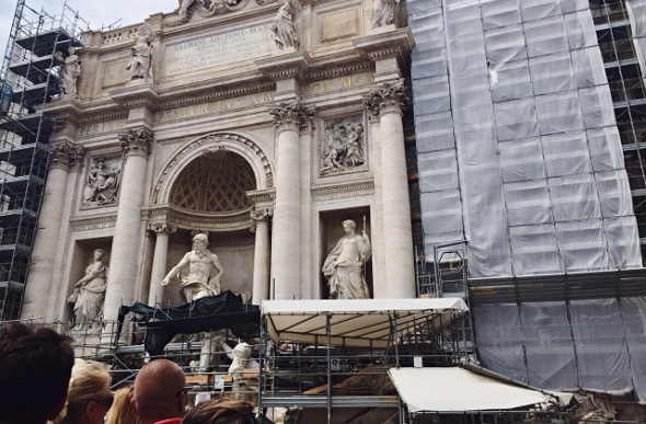 The famous Trevi Fountain is obscured by scaffolding while undergoing maintenance