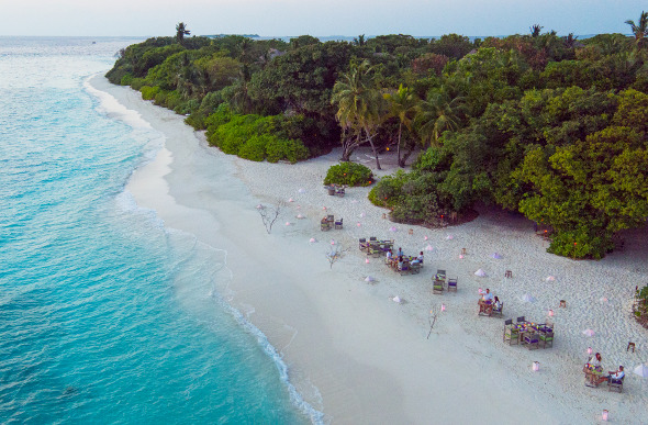 An aerial view of the beachside dining at By the Beach at Soneva Fushi