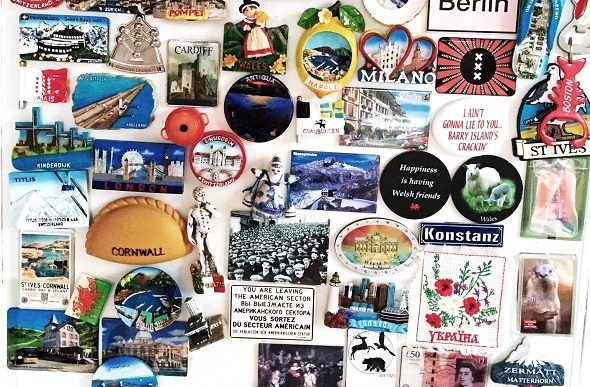Colourful destination magnets fill the space on a fridge.