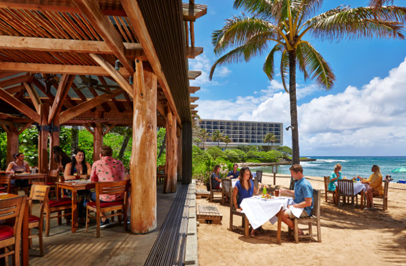 At Ola restaurant at Turtle Bay Resort, people can dine inside or outside on the sand
