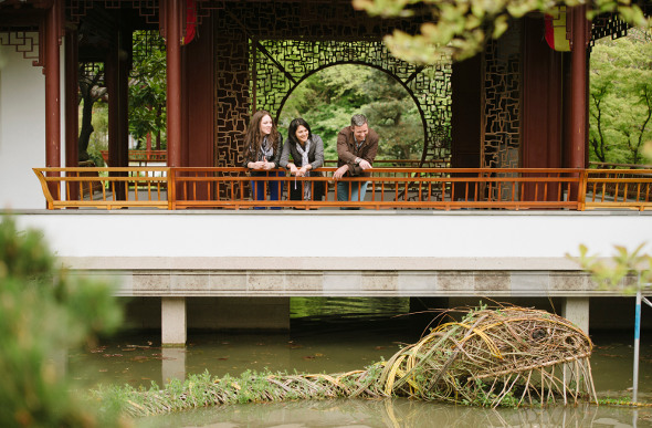 People look into a lake at Dr Sun Yat-Sen Classical Chinese Garden in Vancouver