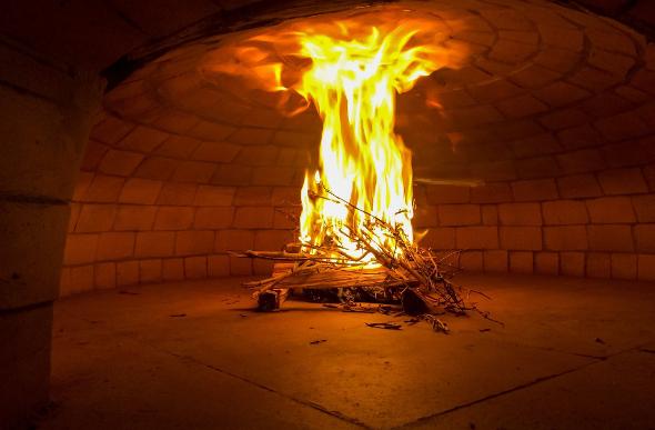 A deep wood-oven fire