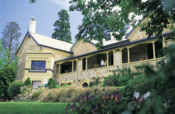 The restored Mt Lofty House with garden and trees