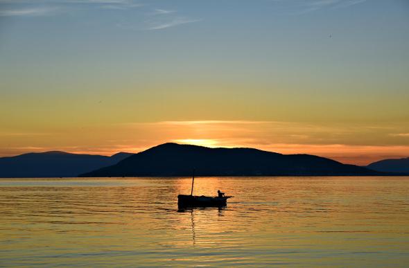 A rich orange sunset over Aegina