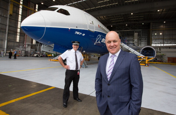 Air New Zealand CEO Christopher Luxon standing in front of the company's first Boeing 787 jet