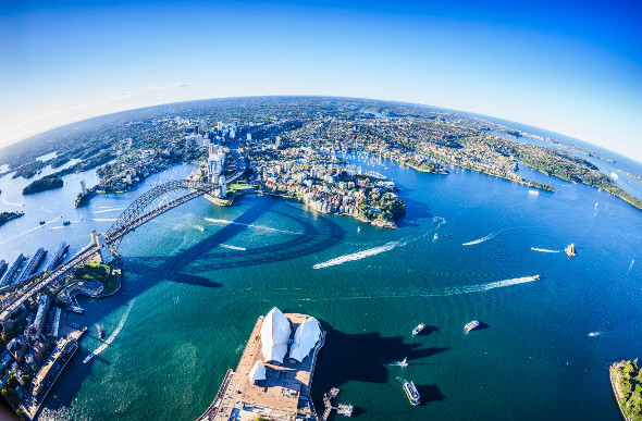 The white wakes of boats trail across Sydney Harbour, Australia. Picture: Getty Images