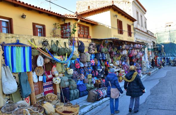 Plaka market stalls selling bags