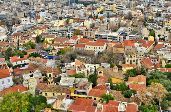 Pastel-coloured houses in Plaka below the Acropolis