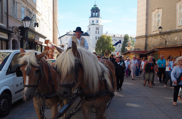 A horse-drawn carriage and people in Salzburg