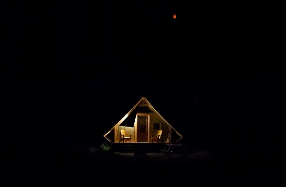A peaceful 'oTENTik' tent cabin at night in the Banff national park.