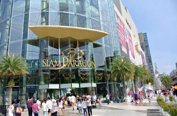 The stylish exterior facade of Siam Paragon with people outside