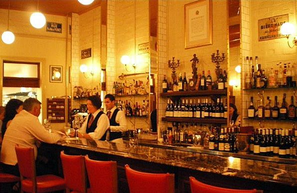 The glowing vintage inspired bar inside Montrachet restaurant.