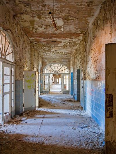 Ruined hallway in abandoned hospital