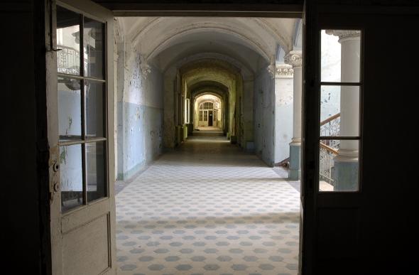 Empty hallway in abandoned hospital
