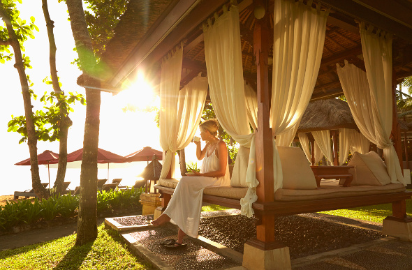 Woman sitting on a luxury bungalow in Bali