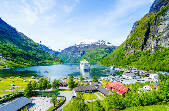A cruise ship surrounded by fjords in Norway