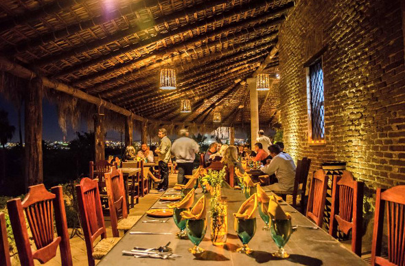 People sitting around a table at Los Tamarindos