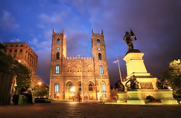 Montreal's Notre-Dame Basilica is lit up at night.