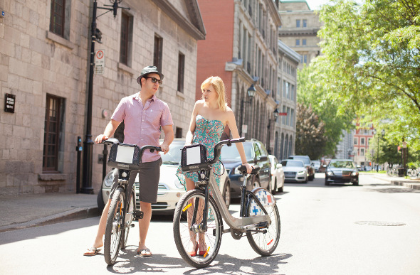 A couple on bikes in Montreal, Canada.