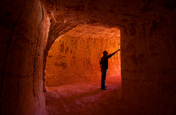 A man stands in an opal-mining tunnel in Coober Pedy.