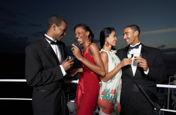 Four friends in formal attire on a cruise ship