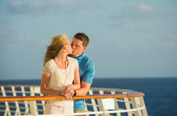 Couple kissing on cruise ship