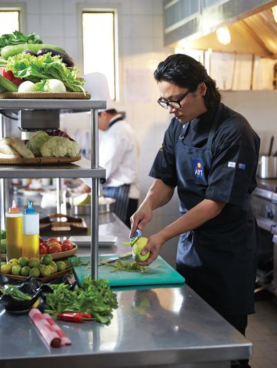 Luke Nguyen working in the kitchen